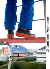 Man in a blue man on a scaffolding - Craftsmen in the blue...