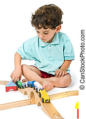 boy playing with train - little boy playing with toy train...
