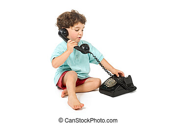 young boy talking on a retro phone