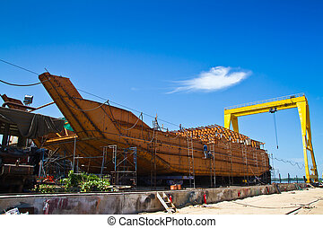 Ship construction in dockyard and blue sky