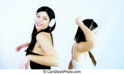 Happy girlfriends dancing