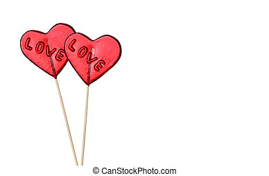 Lollipops heart shaped isolated on white