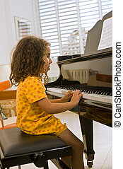 little girl playing the piano - little girl playing the...