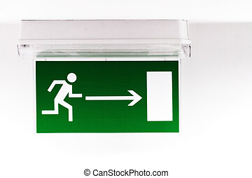 Emergency exit sign in a building glowing green
