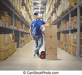 Courier at work with stack of boxes