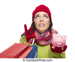 Stressed Mixed Race Woman Holding Shopping Bags and...