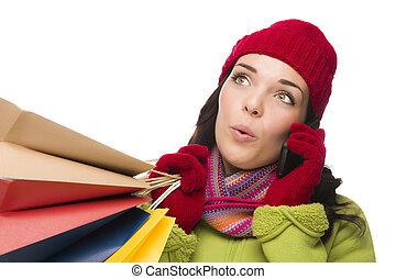 Mixed Race Woman Holding Shopping Bags On Cell Phone Looking