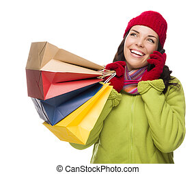 Mixed Race Woman Holding Shopping Bags On Cell Phone Looking Up