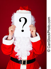 Santa holding question mark in front of his face - Portrait...