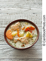 Fish soup with salmon, cream and vegetables