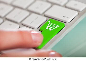 Hand On Green Shopping Cart Button - Close-up Of Hand Over...