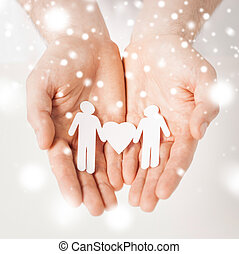 man hands with paper men - gay, lgbt, human rights concept -...