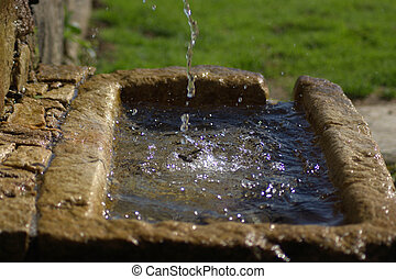 water fountain - Water fountain with a stone in the freely...