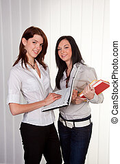 Young girls with their College Maps - Two young women...