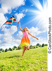Teenage girl with kite - Happy 14 years old girl running in...