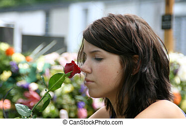 young woman at the cemetery - symbol photo