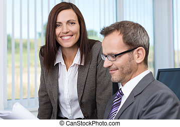 Smiling secretary with her boss