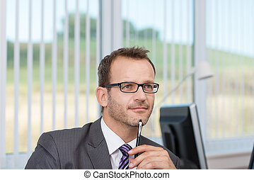 Businessman sitting thinking - Good looking young...