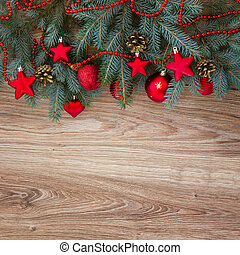 decorated fir tree border on wooden background