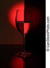 wine glass lighted red light - still-life with wine glass...