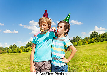 Boys making noise on birthday party