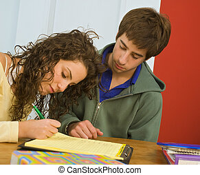 teenagers studing - teenager couple studing together