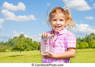 6 years old girl with butterfly jar - Little happy 6 years...