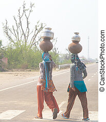India women with pots on their head