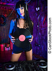 discotheque - Beautiful sexual DJ girl working on a party in...