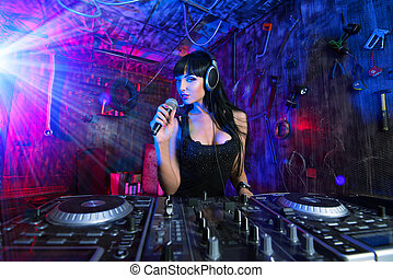 speaking DJ - Beautiful sexual DJ girl working on a party in...