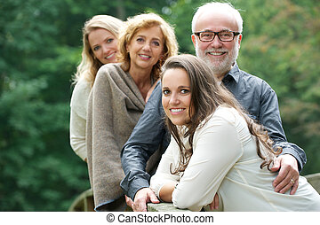 Smiling family happy together outdoors