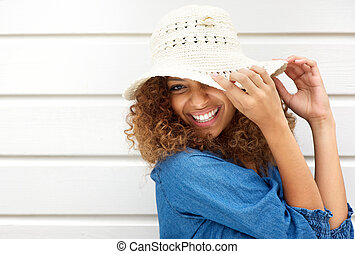 Portrait of a happy young woman wearing hat - Closeup...