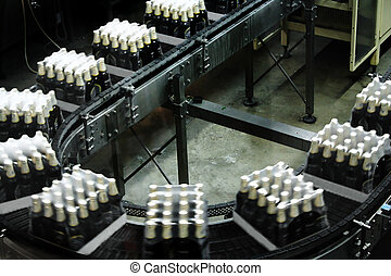 conveyor - Packings of beer on a tape of the conveyor