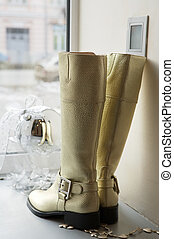 boots on a show-window - Female boots on a show-window of...