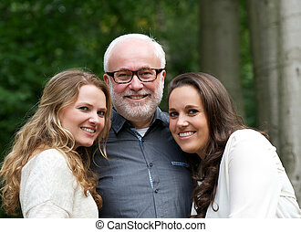 Happy father together with two smiling daughters - Closeup...