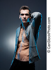 Ripped young guy. - Portrait of a lean muscular young...
