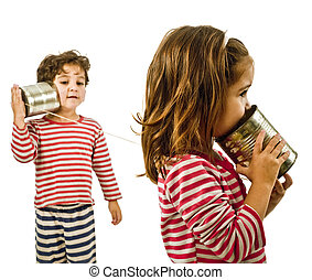 two kids talking on a tin phone - boy and girl talking on a...