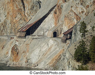 railroad tunnel - a rock and snow shed on a train track