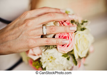 Bride's hands with flowers - Close up of bride's hands with...