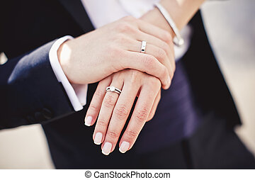 Holding hands with wedding rings - Close up of holding hands...