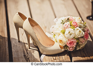 Wedding bouquet and bride shoes - Close up of wedding...