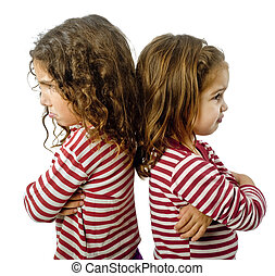 two girls in quarrel - two little girls back to back in...