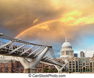 Rainbow over Millennium Bridge in London. St Paul Cathedral...
