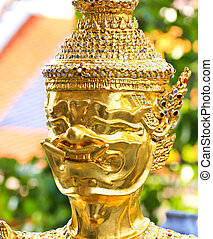 Golden statue in Wat Phra Keao in the Grand Palace in...