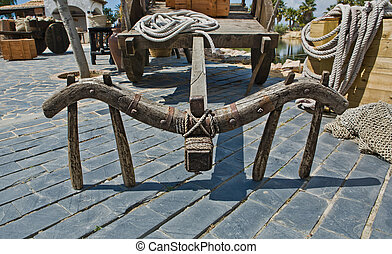 Old horse cart - Old horse two wheels cart leaning on his...