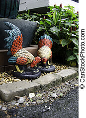 Home decor. - Statue of chickens used in home decor.