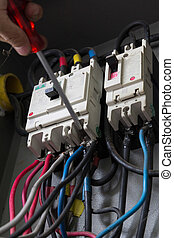 circuit breaker - Man working on a circuit breaker