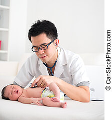 asian doctor and newborn baby on the clinic , monitoring...