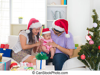 Asian chinese young family celebrating christmas