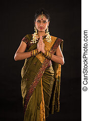 indian female in traditional saree dress and diwali greeting...